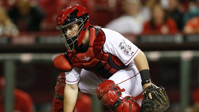 Cincinnati Reds catcher Tucker Barnhart (16) chases down a loose ball in the ninth inning.