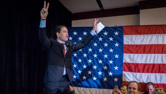 Marco Rubio acknowledges the crowd after addressing