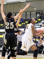 Alamogordo's Shiness Hills, right, gets past Chaparral's Priscilla Marquez on a scoring attempt.