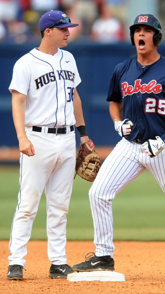 Mississippi's Colby Bortles (25) celebrates an RBI double as Washington's Branden Berry (36) covers second base during an NCAA college baseball regional game at Oxford-University Stadium on Monday, June 2, 2014, in Oxford, Miss. (AP Photo/Oxford Eagle, Bruce Newman) NO SALES.