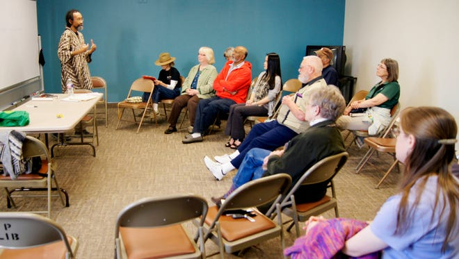Scott discusses the history of African-Americans at the Silver City Public Library on Tuesday. Scott has taught African American History to university and high school students across the U.S.