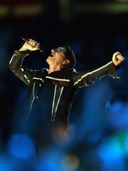Bono and U2 perform during half time show at Super