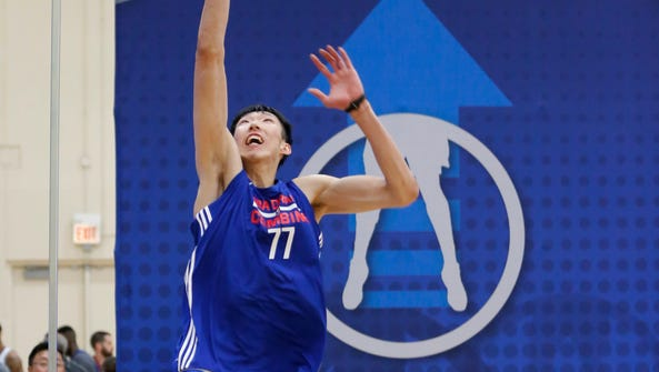 Zhou Qi, from China, participates in the NBA draft