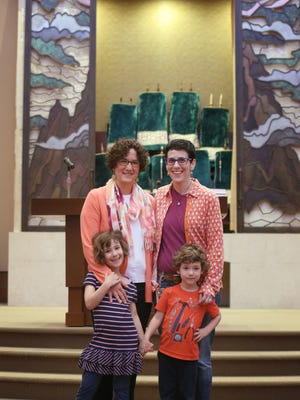Elisa Abes and Amber Feldman photographed with their children, Shoshana, 6, and Benjamin, 4, inside of the Adath Israel Synagogue where they would like to be married, if the State of Ohio law was overturned.