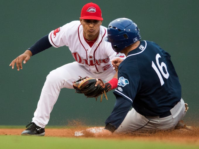 Santiago Espinal (2) of the Greenville Drive attempts