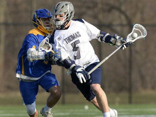 Webster Thomas' Matt Hill, right, is defended by Irondequoit's