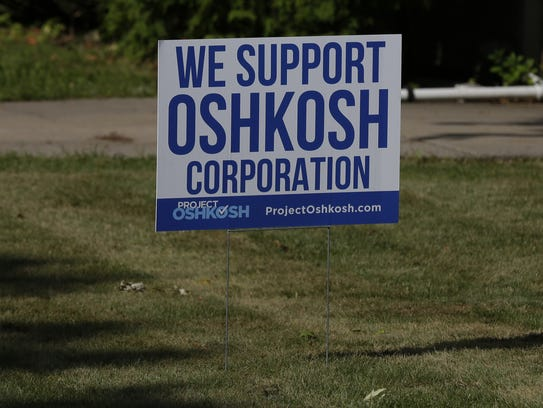 A yard sign expresses support for Oshkosh Corp.