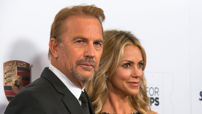 Kevin Costner and wife Christine Baumgartner attend the AARP's Movies for Grownups Awards Gala on Feb. 2.