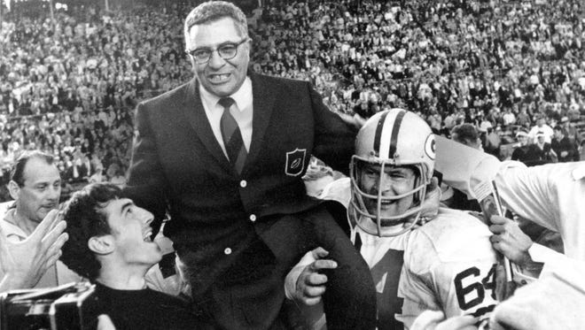 Former Green Bay Packers coach Vince Lombardi is carried off the field on Jan. 14, 1968, after his team defeated the Oakland Raiders 33-14 in Super Bowl II in Miami. Former Packers great Jerry Kramer is at right.