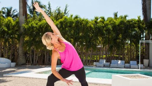 Miami fitness instructor Jessica Smith strikes a yoga pose for a recent DVD. But Smith says she puts most of her workouts on streaming video these days.