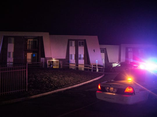 New Castle County police investigate the scene of a shooting at Spring Crossings in Newark Wednesday night.