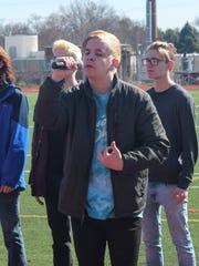 Freshman Colin Jatczak sings during the walkout Friday