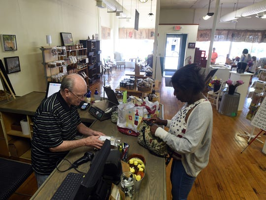 Keller Market House employee Larry Garlinger, left,