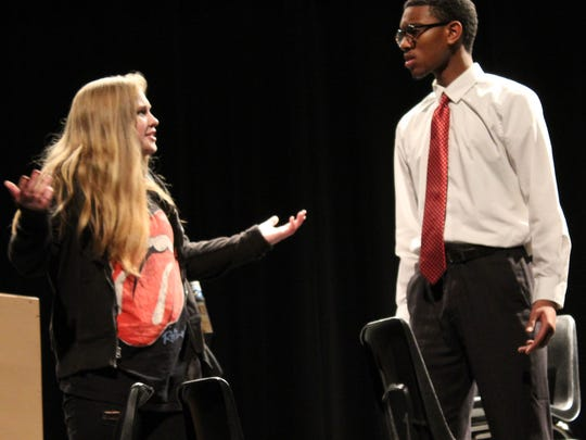 "Alice (senior Sarah Frazier) is confronted by high school principal (senior Elijah Evans) regarding the whereabouts of her brother in this rehearsal scene from ""Governing Alice,"" one of two Abilene High School drams being performed this weekend."