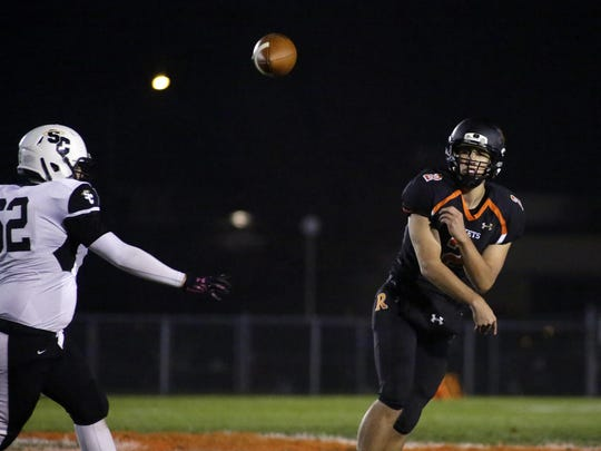Cedar Grove-Belgium's Josh Weiss (2) passes the ball during action with Racine St. Catherines Friday October 28, 2016 at Cedar Grove.