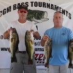 Jason Mabry (left) and Lance Graves used a midday schooling bite to produce 19.32 pounds in Saturday's CGM bass tournament on Barnett Reservoir.