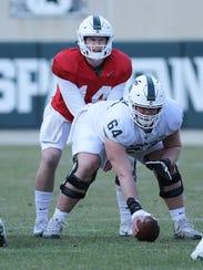 Michigan State quarterback Brian Lewerke takes the