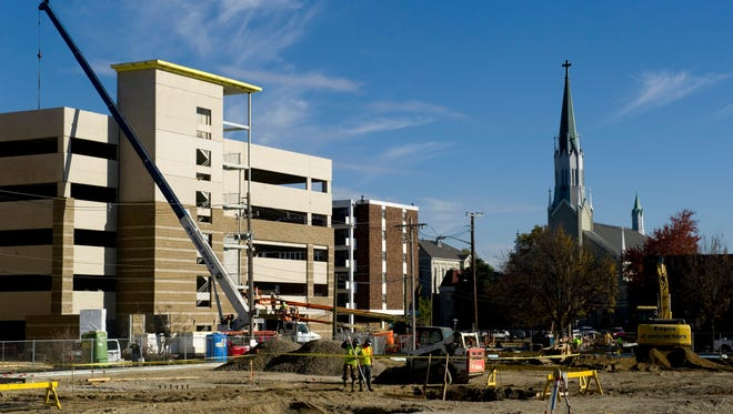 Foundation work for the Multi-Institutional Academic Health Science & Research Center continues next to the parking structure for the new Evansville Doubletree Convention Center Hotel Monday afternoon. The school plans to open in the Fall of 2018 and serve between 500-600 students.
