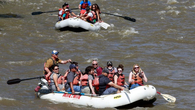 Visitors to Riverfest head down the Animas River on May 28, 2016, near Berg Park. This year's event runs Friday through Sunday.