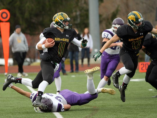 Burr and Burton's Griffin Stalcup rushes the ball in the first half of last year's Division II high school football state championship win over Bellows Falls.