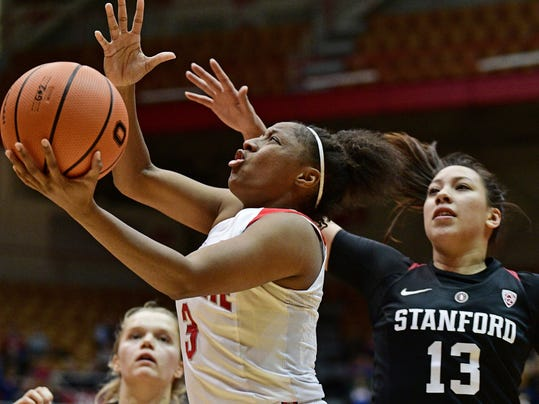 FILE - In this Nov. 10, 2017, file photo, Ohio State's Kelsey Mitchell, front left, drives to the basket on Stanford's Marta Sniezek, right, during the fourth quarter of an NCAA college basketball game in Columbus, Ohio. The Associated Press polled a panel of WNBA coaches and general managers for a mock draft of the first two rounds of the league's draft this spring. Panelists were limited to college seniors and eligible foreign players, and they could not offer a pick for their own team. Mitchell will give the Fever a top offensive threat to build around. (AP Photo/David Dermer, File)