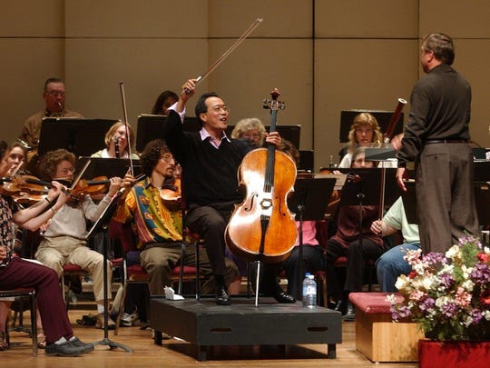 Consummate cellist Yo-Yo Ma rehearses with the Great Falls Symphony before a 2004 performance in Great Falls. Fundraising done each year helps bring big acts to the Electric City.
