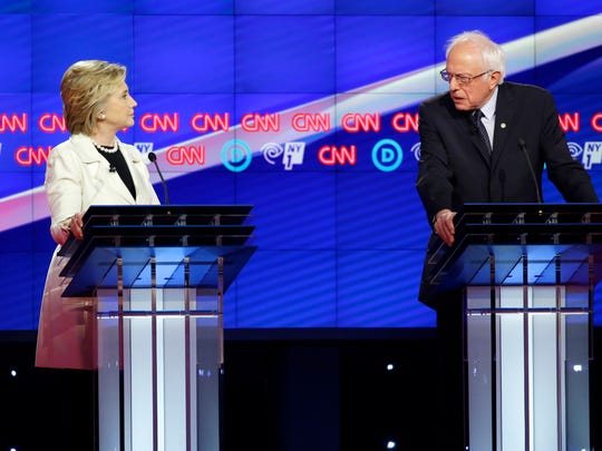 Hillary Clinton and Bernie Sanders take part in a debate in Brooklyn on April 14, 2016.