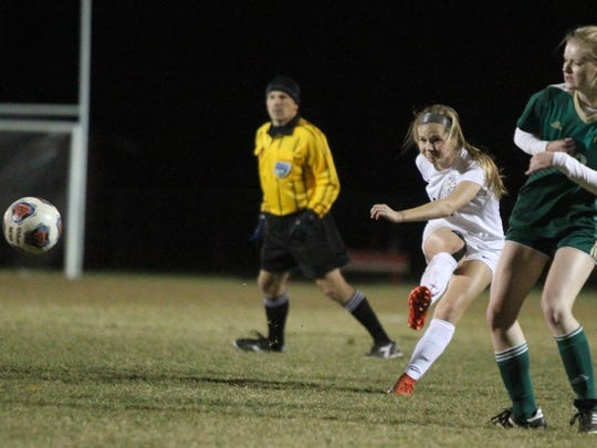 Leon's Emma McGibany fires a shot against Lincoln.