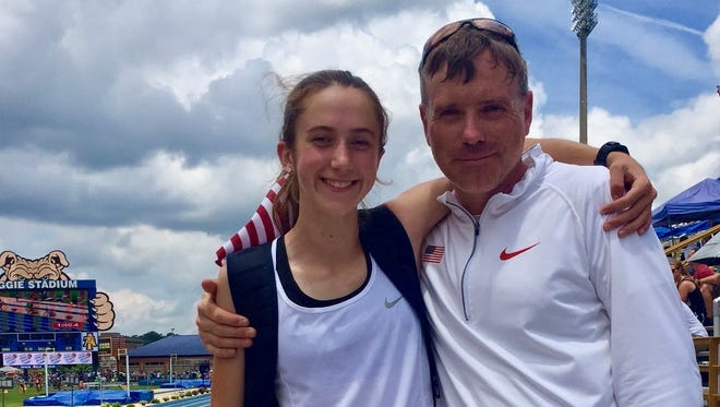 Alex Harris with her coach, Barry Baloga, after she won the girls 2,000 steeplechase title at New Balance Nationals