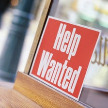 """""""Help Wanted"""" sign in window."""