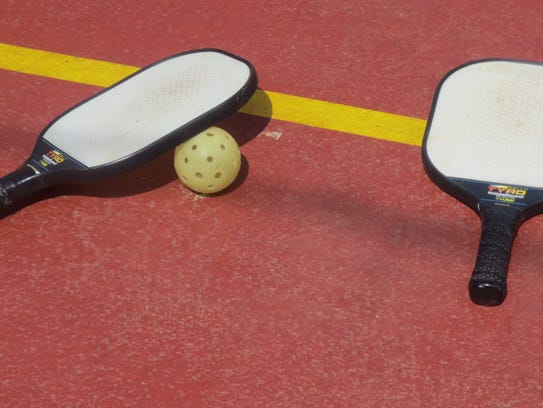 Pickleball paddles and ball.