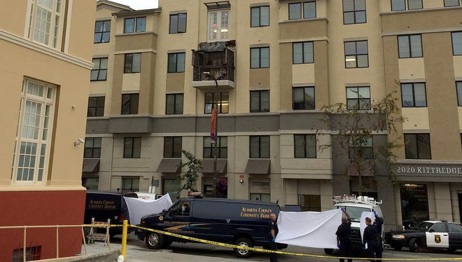 Police and officials stand outside of the Library Gardens apartment complex, where a fourth floor balcony rests on the balcony below after collapsing in Berkeley, Calif., Tuesday, June 16, 2015. Berkeley police say several people are dead and others injured after a balcony fell shortly before 1 a.m., near the University of California, Berkeley. (AP Photo/Kristin Bender)