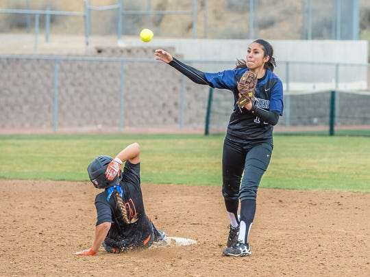 Piedra Vista's Autumn Begay tries to turn a double play after getting Aztec's CheyAnne Simkins out at second base on Friday at the Farmington Sports Complex.