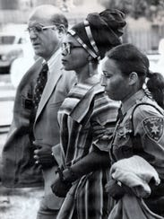 Joanne Chesimard, center who was indicted in the May