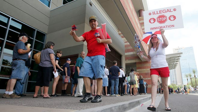 Supporters of GOP presidential candidate Donald Trump rally before he speaks on July 11, 2015, in Phoenix.