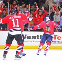 Game 6: Chicago Blackhawks center Andrew Shaw (65) is congratulated for scoring by center Andrew Desjardins (11) during the third period of the Blackhawks' 5-2 win.