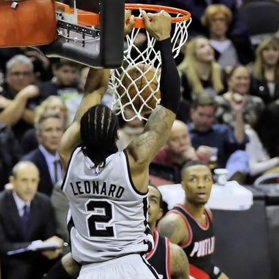 Spurs forward Kawhi Leonard leads the team in scoring