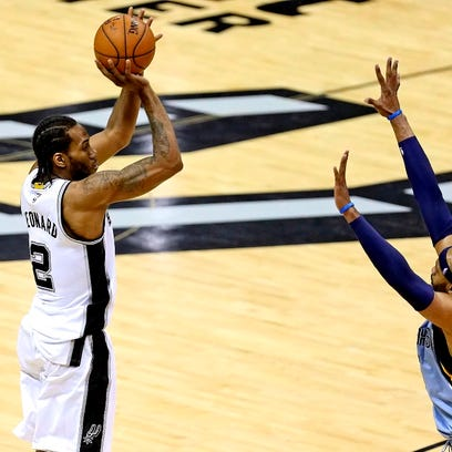 Forward Kawhi Leonard, shooting over Memphis guard