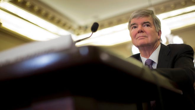 National Collegiate Athletic Association (NCAA) President Mark Emmert prepares testify on Capitol Hill in Washington, July 9, 2014, before the Senate Commerce hearing on the NCAA's treatment of athletes.