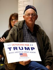 An audience member listens as Republican presidential candidate Donald Trump speaks during a campaign rally at the Veterans Memorial Building, Saturday, Dec. 19, 2015, in Cedar Rapids, Iowa. (AP Photo/Charlie Neibergall)