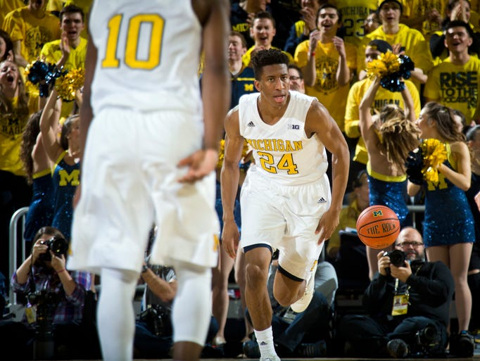 Michigan guard Aubrey Dawkins (24) reacts in celebration