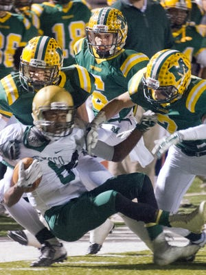 Mayfield's defense swarms Jaguars running back Aaron Bean to hold him to a short gain Friday night at the Field of Dreams.
