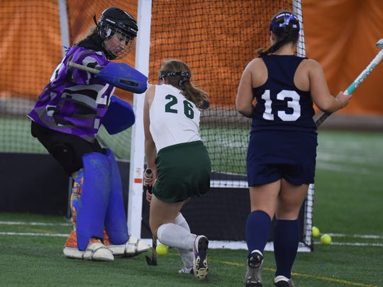 Pine Plains' goalie, Amanda Simmons fends off a shot from Webutuck's Isabella Tomasetti during the Section 9 Class C final on Friday in Milton.
