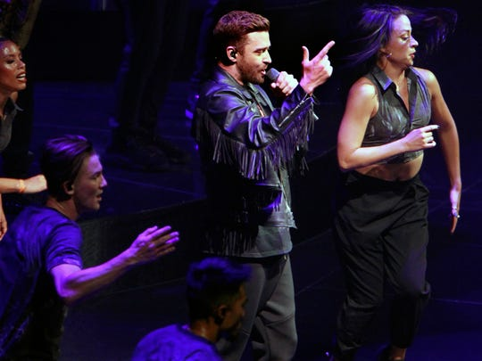Justin Timberlake, surrounded by his dancers, performs