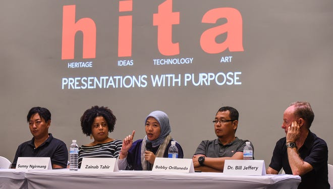 Zainib Tahir, center, a maritime archaeologist with The Republic of Indonesia's Ministry of Marine Affairs and Fisheries, talks about proposed regulations addressing recreational diving in her home country, during the Heritage, Ideas, Technology, Art (HITA) Talk: World War II, Underwater Cultural Heritage in the Asia-Pacfic Region presentation at the Guam Museum in Hagåtña on Saturday, July 22, 2017.