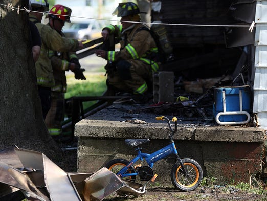 A 3-year-old boy died in a house blaze May 8, 2014, in Muncie, Ind. The mother of the 3-year-old boy, her younger child and a man were hurt in the fire.