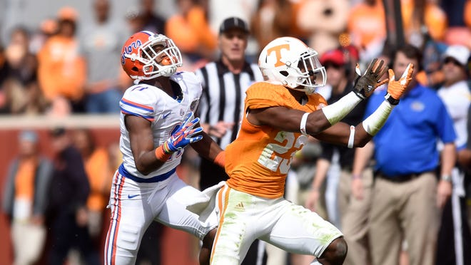 Tennessee defensive back Cameron Sutton (23) intercepts a pass intended for Florida wide receiver Demarcus Robinson (11) uring the first half of an NCAA college football game at Neyland Stadium, Saturday, Oct. 4, 2014, in Knoxville, Tenn. (AP Photo/Knoxville News Sentinel, Saul Young)