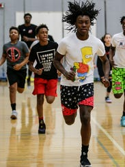 Javaughn Hannah of Mount Clemens, right, works out