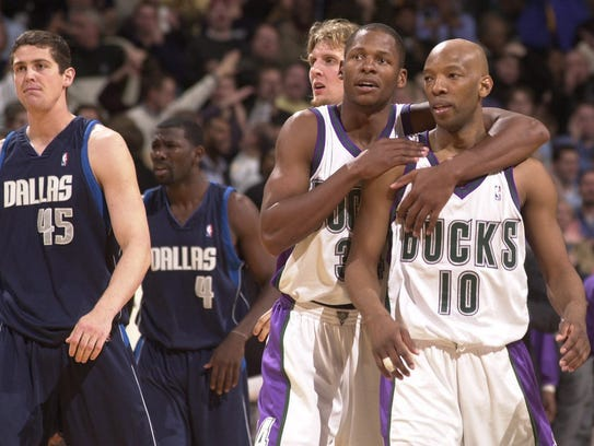 Ray Allen and Sam Cassell embrace after the Bucks knocked