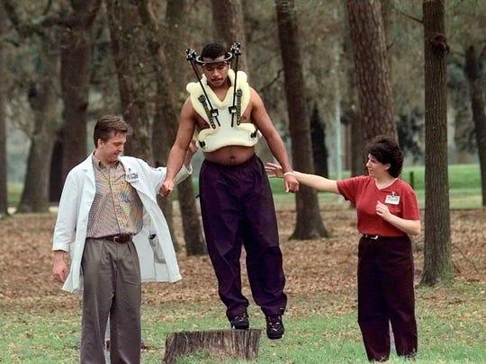 Reggie Brown, center, works on his balancing during